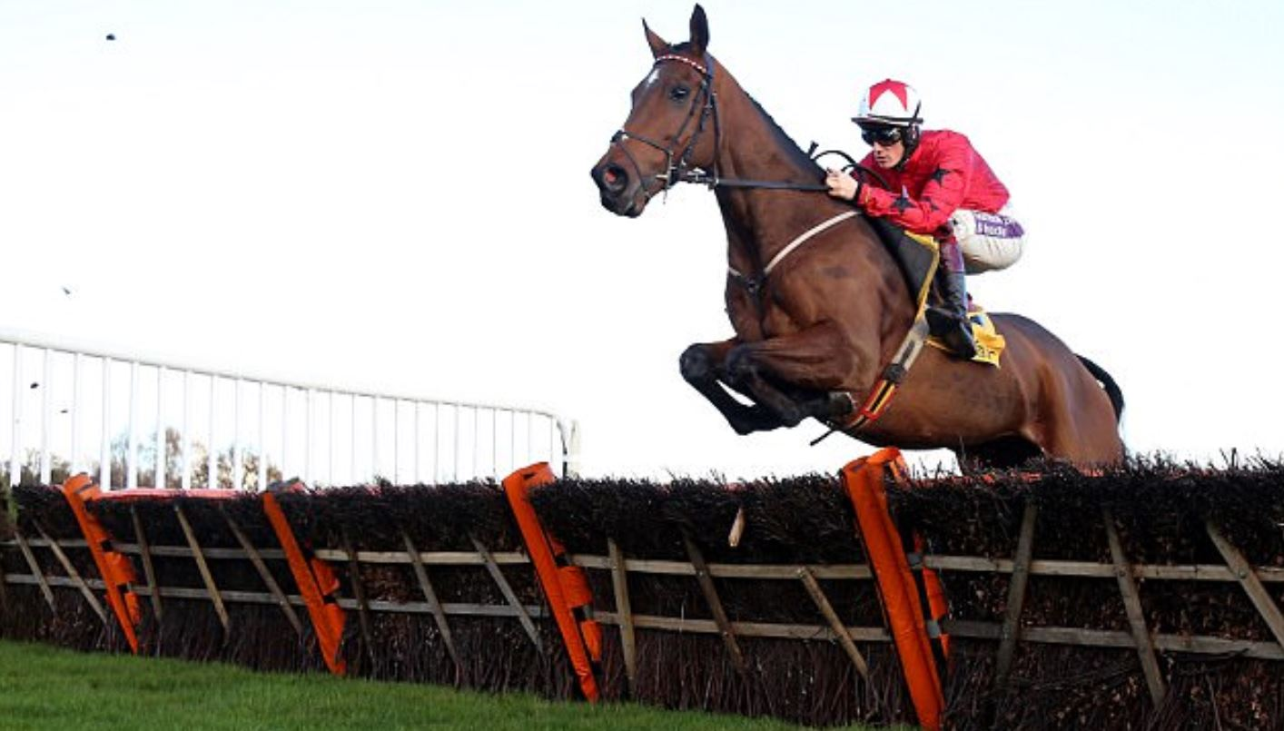 The New One and Sam Twiston-Davies jump a hurdle