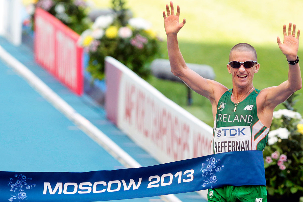 Rob Heffernan crosses the finish line to win the 50km Walk at the 2013 World Championships in Moscow - photo by Augustas Didzgalvis