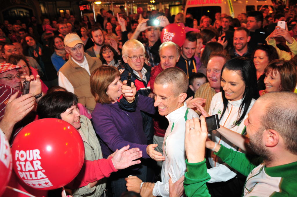 Race Walker Rob Heffernan is swamped by fans at his homecoming in Cork City after winning the 2013 World Championships in Moscow