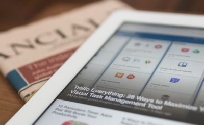 newspaper and a tablet
