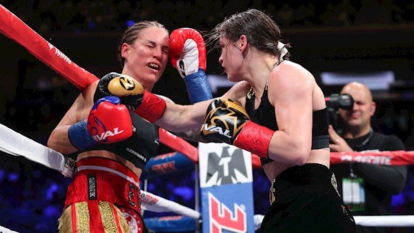 Katie Taylor lands a right cross with her opponent, Eva Wahlstrom, on the ropes during their WBA and IBF World Lightweight Championship fight at Madison Square Garden, New York. The win sets Taylor up for a blockbuster 2019 where she hopes to win all four belts in the division. Picture: Ed Mulholland/Matchroom Boxing USA via Sportsfile