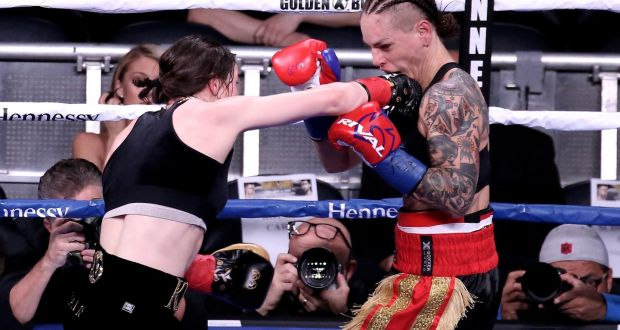 Katie Taylor lands a punch to the face of Eva Wahlstrom during their WBA and IBF lightweight world title bout at Madison Square Garden, New York, on Saturday night.
