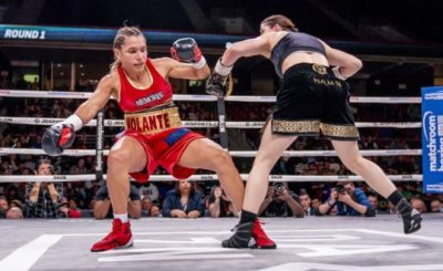 Katie Taylor knocks down Rose Volante during their title fight in Philadelphia. Photo: Tom Hogan/Inpho