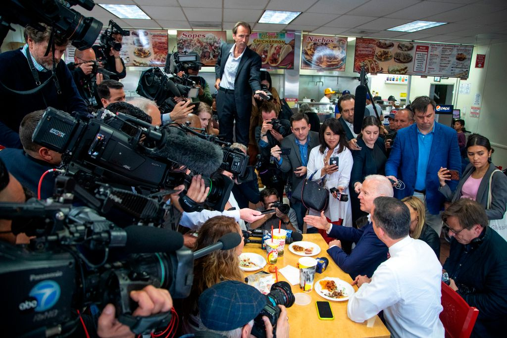Former US Vice President and front-running Democratic presidential candidate Joe Biden and Los Angeles Mayor Eric Garcetti (R) speaks to reporters during a campaign stop at a King Taco shop in Los Angeles, California on May 8, 2019. (Image: Getty Images)