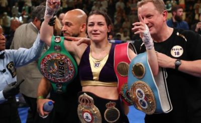 Katie Taylor celebrates with all four belts after her win over Delfine Pursoon. Photograph: Al Bello/Getty