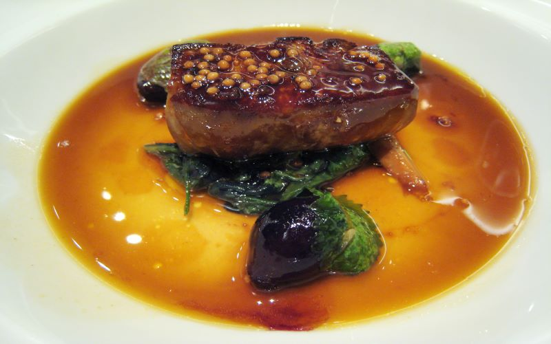 "Foie gras ""en cocotte"" with mustard seeds and spring onions in duck juice. Image: Wikipedia"