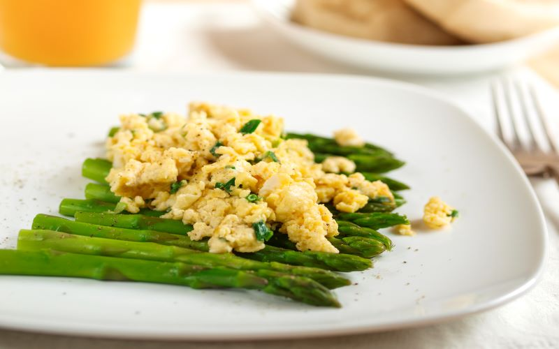 Despite its fancy name, egg à l'argenteuil was simply asparagus with scrambled egg. Image: Getty